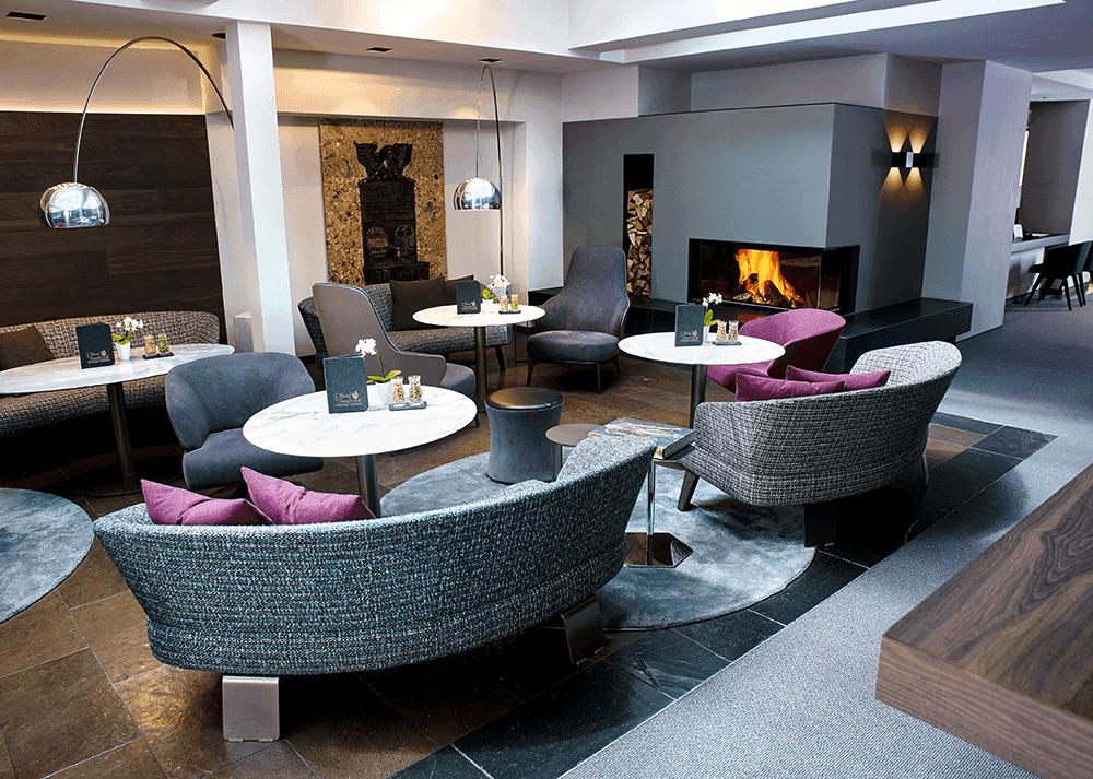 HotelinnsbruckMICELocationBoutiqueConventionMinotti-Lounge-mit-Holz-Kamin-eng-Hotel-Insnbruck-Hotel-in-Innsbruck-Innsbruck-Tirol-AustriaSeminareinTirol0
